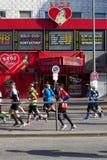 Marathoners Pass through St. Pauli. April 21, 2013 - Hamburg, Germany: Marathoners pass by the brothels and strip clubs of Hamburg's infamous red light district Stock Photos