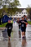 Marathoners running in cold rainy wet conditions, royalty free stock photos