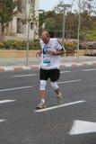 Maratona de Telavive Gillette. Superando a dor Imagem de Stock