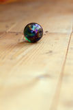 Marball on wood floor. A pretty marbell on a wooden floor Royalty Free Stock Photo