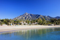 Marbella Beach on Costa del Sol. Marbella sandy beach, summer holiday scenery by the Mediterranean Sea in Spain, Andalusia region, Costa del Sol, Malaga province Royalty Free Stock Images