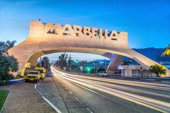 Marbella Entrance Arch at dusk stock photography