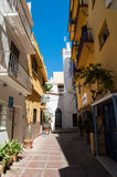 Marbella old street. Marbella old street with blue sky, white and yellow buildings Royalty Free Stock Photos
