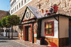 Christmas house decorated with Santa`s sleigh on the roof at central square of town. MARBELLA, SPAIN - DECEMBER 2017: Christmas house decorated with Santa`s stock photography