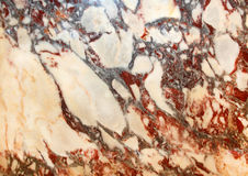 Marble. Beige marble with red line Royalty Free Stock Photography