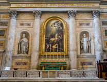 Marble altar with paintings and statues among the columns in the catholic church cathedral basilica of Saint Paul in Rome, Italy. Marble altar with paintings and royalty free stock photo