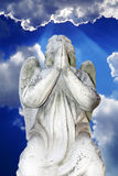 Marble angel on a background of blue sky Royalty Free Stock Photo