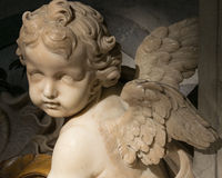 Marble angel. On the holy water of San Pietro in Rome Stock Photos