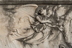 Marble angel relief on a tombstone in the cemetery of Menton on Stock Image