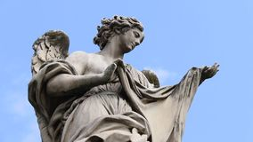Marble Angel  Statue on the Ponte Sant`Angelo. Angel on guard of Rome, statue of an angel on the background Castle Sant Angelo, Rome, Italy stock footage