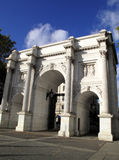Marble Arch. Made of Italian marble was designed by John Nash in 1828 and was originally the entrance to Buckingham Palace, but was moved to its present Stock Photos