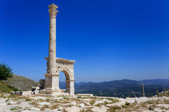 Marble arch and column at ancient city of Sagalassos. Ancient city Sagalassos ruins columns, sculpture and big stones Stock Photo