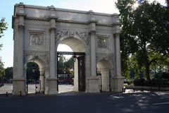 Marble Arch Gates, London UK. The Marble Arch Gates in London, UK. This triumphal arch was designed by John Nash and is currently located at the intersection of Stock Photos