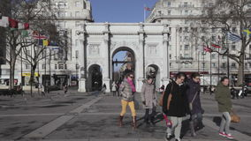 Marble Arch London. LONDON, UNITED KINGDOM - JANUARY 27, 2013: Marble Arch Crowded With Tourists at Windy Winter Day in London, United Kingdom stock video footage