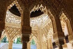 Marble arches, Alhambra Palace. Marble arches forming the arcades surrounding the court of the Lions (Patio de los leones), Palace of Alhambra, Granada, Granada Royalty Free Stock Image