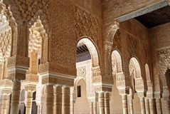 Marble arches, Alhambra Palace. Marble arches forming the arcades surrounding the court of the Lions (Patio de los leones), Palace of Alhambra, Granada, Granada Royalty Free Stock Images