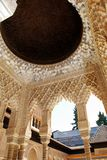 Marble arches, Alhambra Palace. Marble arches forming the arcades surrounding the court of the Lions (Patio de los leones), Palace of Alhambra, Granada, Granada Royalty Free Stock Photos