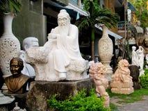Marble asian sculptures Stock Photos