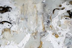 Marble background texture with gold, black, grey and white colors, using acrylic pouring medium art technique. Useful as a backdro royalty free stock images