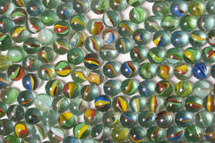 Marble Balls. Marbles spread out over a background Stock Photography