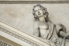 Marble baroque white statue of girl woman laying Royalty Free Stock Photo