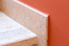 Marble baseboard at marble stairs. Closeup Stock Photos