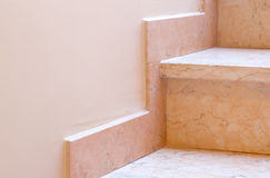 Marble baseboard at marble stairs. Closeup Royalty Free Stock Photography