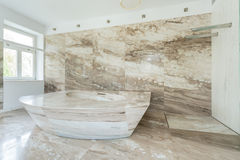 Marble bath. Photo of enormous marble bath in spacious bathroom Stock Photos