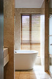 Marble bathroom. A picture of a sparkling clean bathroom, in a brown marble theme Stock Images
