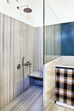 Marble bathroom. A picture of a sparkling clean bathroom, in a gray marble theme. Includes a shower stock photography