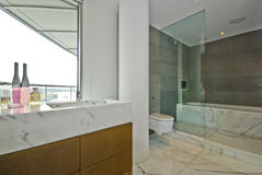 Marble bathroom. Luxury marble bathroom with floor to ceiling window Royalty Free Stock Image