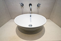 Marble bathroom detail. With designer round hand wash basin Royalty Free Stock Photo