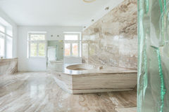 Marble bathroom in expensive house Royalty Free Stock Photos