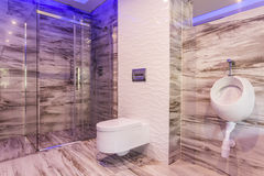 Marble bathroom with glass shower enclosure Royalty Free Stock Photos