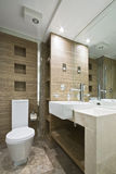 Marble bathroom with mosaic tiles. And wooden walls Royalty Free Stock Image