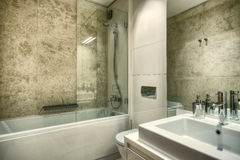 Marble bathroom. Marble stylish and cosy bathroom in modern house Stock Photography