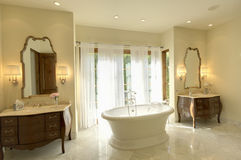 Marble Bathtub With Cabinets And Mirror Royalty Free Stock Photo