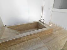 Marble bathtub in a modern bathroom Stock Photos