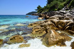 Marble Beach - rocky shore Stock Image