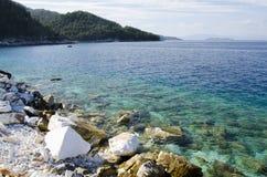 Sea view. Marble beach sea shore clifs and rocks Stock Photo