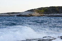 Sea view. Marble beach sea shore clifs and rocks Royalty Free Stock Images