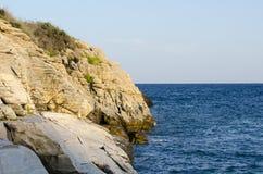 Sea view. Marble beach sea shore clifs and rocks Royalty Free Stock Photos