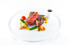 Marble beef stake vegetables. White plate Royalty Free Stock Photo