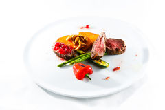 Marble beef stake vegetables. White plate Stock Photography