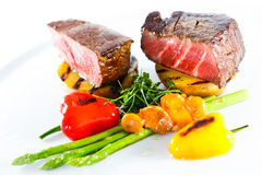 Marble beef stake vegetables. White plate Royalty Free Stock Photos