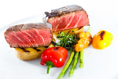 Marble beef stake vegetables. White plate Royalty Free Stock Images