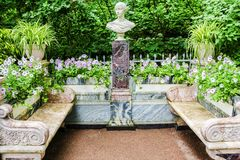 Marble bench in the gardens of Peterhof, Russia Royalty Free Stock Images
