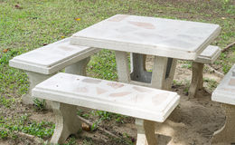 Marble bench and table in the garden Royalty Free Stock Images