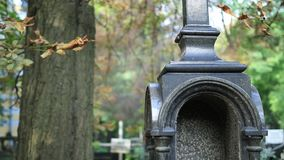 Marble black cross in a graveyard. Obelisk at the old cemetery stock footage