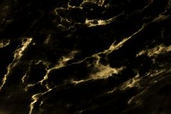 Marble black wall background surface gold  yellow pattern graphic abstract light elegant black .